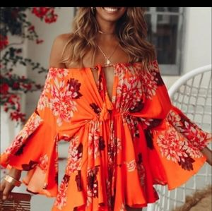 Other - Sexy  vibrant floral bell sleeve romper
